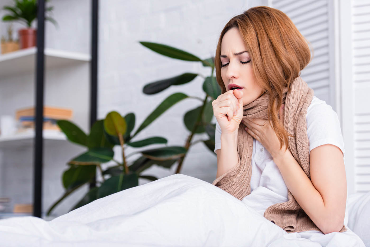 Woman Coughing at home